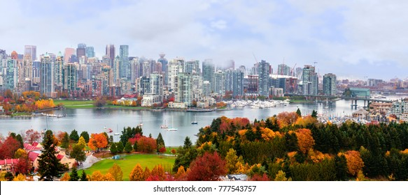colorful autumn landscape of a modern city with yachts and skyscrapers by the river
