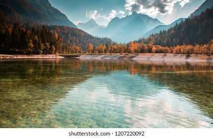 Colorful autumn landscape in the mountain village, Alps and mountain lake in Slovenia - Alpine scenery