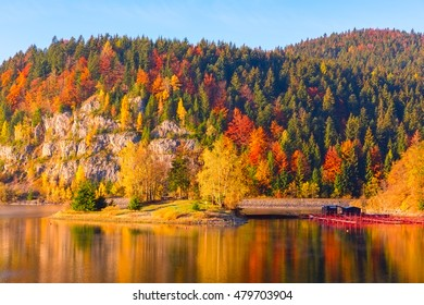 Colorful autumn mountain landscape with multicolored trees, blue sky and reflection in the water, National park Slovak paradise (Narodny park Slovensky Raj), Slovakia - Shutterstock ID 479703904