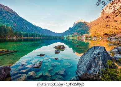 Colorful autumn scene of Hintersee lake. Amazing morning view of Bavarian Alps on the Austrian border, Germany, Europe. Traveling concept background. Orton Effect.