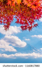 Colorful autumn season & Mountain Fuji in morning fog and red leaves at lake Kawaguchiko, Japan