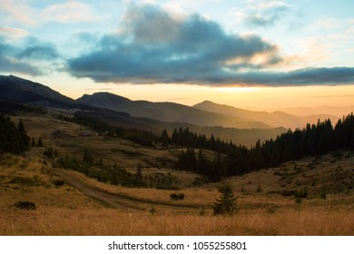 colorful autumn sunset in Europe mountains, picturesque scenic scenery, grass in evening sunlight, Carpathian scene, Marmarosy range, popular place for tourism, Ukraine