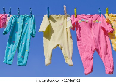 Colorful baby clothing on clothesline
