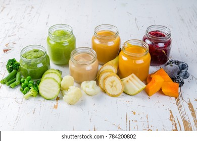 Colorful baby food purees in glass jars
