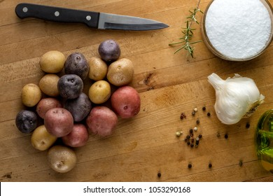 Colorful baby potatoes, garlic and spices
