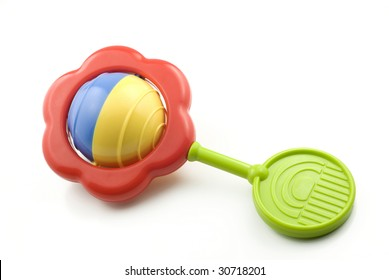 A colorful baby rattle isolated on white with copy space