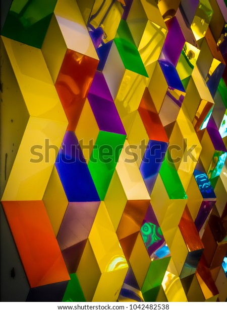 Colorful backdrop The triangular prism is made up of alternating colors.