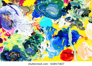 Colorful background. Abstract oil painting on artist palette. Yellow, blue, green, pink colors. Fresh and bright, summer, spring mood. Background and texture for interior design or graphic design.