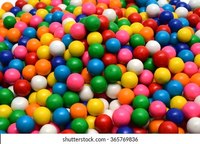 Colorful background of assorted shiny round gumballs