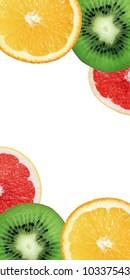 Colorful background from exotic  fruit. Kiwi, orange and grapefruit slices.