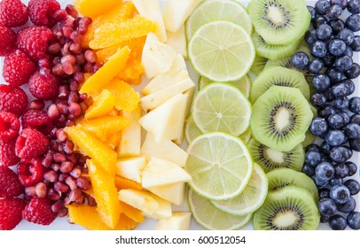 Colorful background made from fresh fruits in rainbow colors