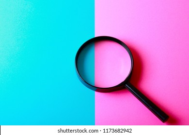 A colorful background with magnifying glass