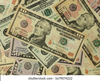 Colorful background with money US dollars of different value. Top view of business concept with finance for banks. American banknotes 5, 10, 50, 100 dollars backdrop