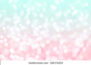 Colorful background with natural bokeh texture and defocused sparkling lights. Turquoise and pink texture with background with twinkling lights. Vintage and pastel colors