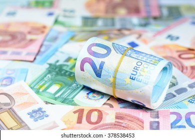 Colorful background with new series of euro currency,money banknotes,Focus on number 20 of currency roll