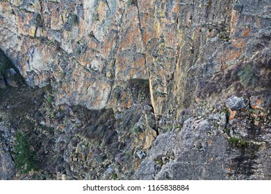 Colorful background texture from Black Canyon of the Gunnison National Park and recreation area at Pulpit Rock, near Montrose, Colorado, USA.