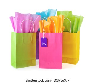 Colorful bags with paper and tag