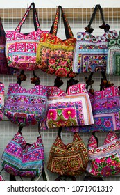 Colorful bags for sale, vertical shot, vivid colors and beautiful textures
