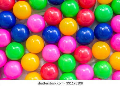 colorful ball, children's party, a games room, a box filled with small colored balls