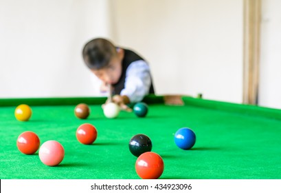 Colorful ball and snooker player,kid play snooker,Focus on pink ball