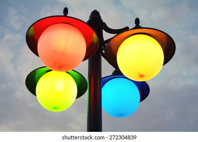 colorful ball street lamps with a cloudy sky background
