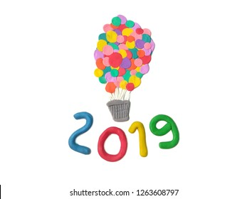 Colorful balloon basket and 2019 new year text on white background are handmade from plasticine clay, beautiful festival shape are dough