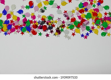 A colorful balloon and stars border with copy space.  Concept celebration, birthday, birth, party, engagement, retirement, and graduation.