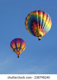 Colorful balloons against a blue sky. Portrait photo ideal for use as a cover.