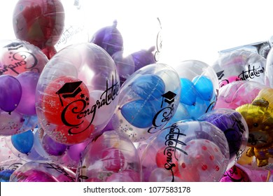 Colorful balloons for congratulations graduation on isolated white background.