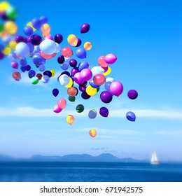 Colorful balloons drifting over the calm blue sea. on the background of the little white boat