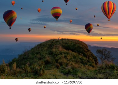 Colorful balloons flying over the mountain and travel concept