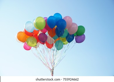 Colorful Balloons On The Air. Blue sky background.