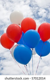 Colorful Balloons On A Cloudy Day In Red, White and Blue