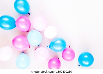 Colorful balloons on pastel color background. Festive or birthday party concept. Flat lay, top view.