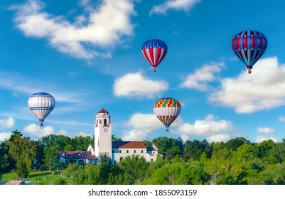 Colorful balloons in the sky over a train depot