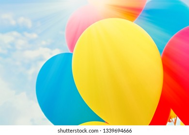 Colorful balloons in the sun against the blue sky.with copy space,