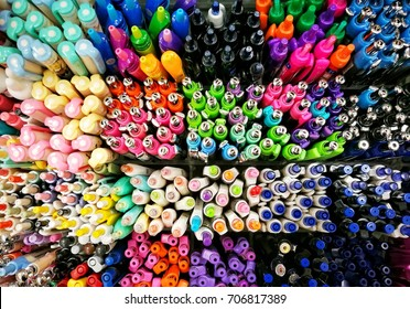 Colorful ballpoint pen tops in stationery shop