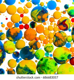 Colorful balls ink oil paint on white