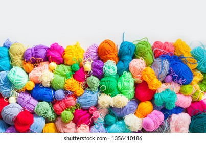 Colorful balls of knitting yarn. Color yarn for knitting, knitting needles and crochet hooks.