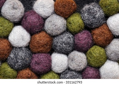 Colorful balls of wool. Colorful felt balls. Dried balls of wool. Colored beads. Felt handmade. Necklace with colorful beads