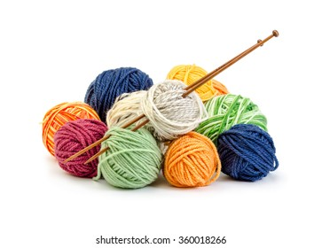 Colorful balls of yarn and wooden needles isolated on white background