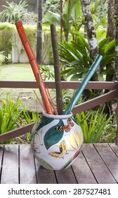 Colorful bamboo sticks in large vase
