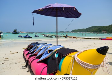 Colorful banana boat with life vest in sunny day
