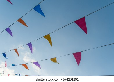 Colorful banderoles for town party and blue sky
