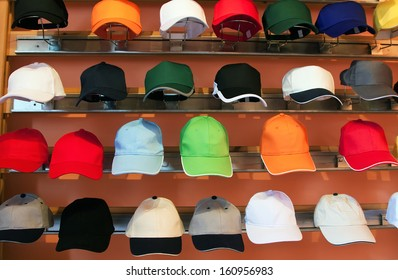colorful baseball caps on exhibition cases