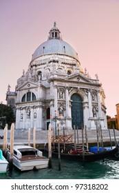 Colorful Basilica di Santa Maria della Salute with gondolas in Venice, Italy