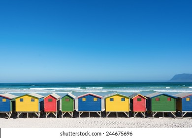 Colorful bathhouses at Muizenberg, Cape Town, South Africa, standing in a row.