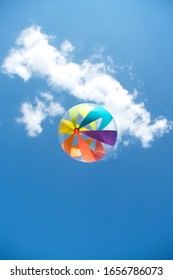 Colorful beach ball against sky