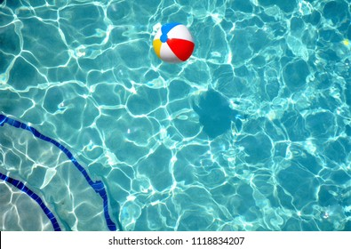 colorful beach ball in clear blue swimming pool