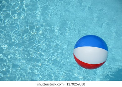 colorful beach ball floating on pool water